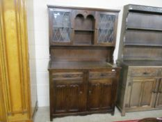 REPRODUCTION DARK OAK DRESSER, THE BACK WITH LEADED GLAZED COMPARTMENTS, 115CM WIDE