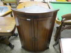 EARLY 19TH CENTURY OAK BOW FRONTED WALL MOUNTING CORNER CUPBOARD, 67CM WIDE
