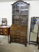 WALNUT BUREAU BOOKCASE, LATER GLAZED TOP AND 18TH CENTURY BASE, TYPICALLY FITTED, 94.5CM WIDE