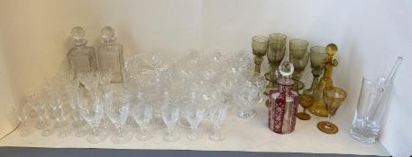 Qty of glass wear to include decanters, cut glass drinking stemmed glasses, tumblers, coloured glass