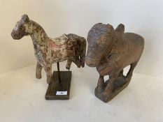 Decorative model of a horse on a wooden plinth and a cow