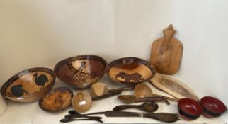 Quantity of wooden bowls and serving spoons etc (Condition: all from house clearance so all with