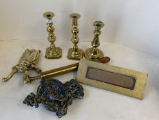 Qty of brass candle sticks and boot jack in the form of beetle, brass letter box & door knocker.
