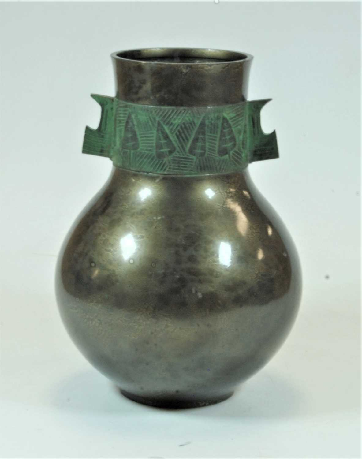 Lot 26 - A Japanese Showa period bronze metal vase of bulbous form, the frieze having a band incised with