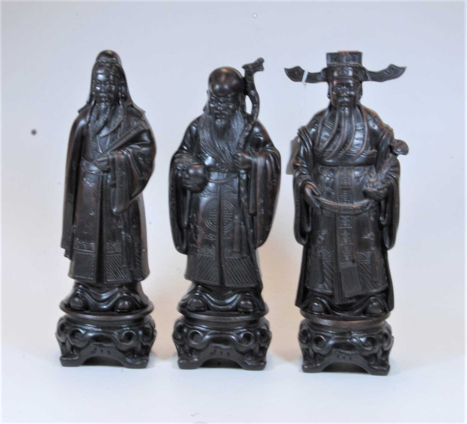 Lot 17 - A set of three modern resin figures of the gods Fu, Lu and Shou, the 3 gods of happiness,