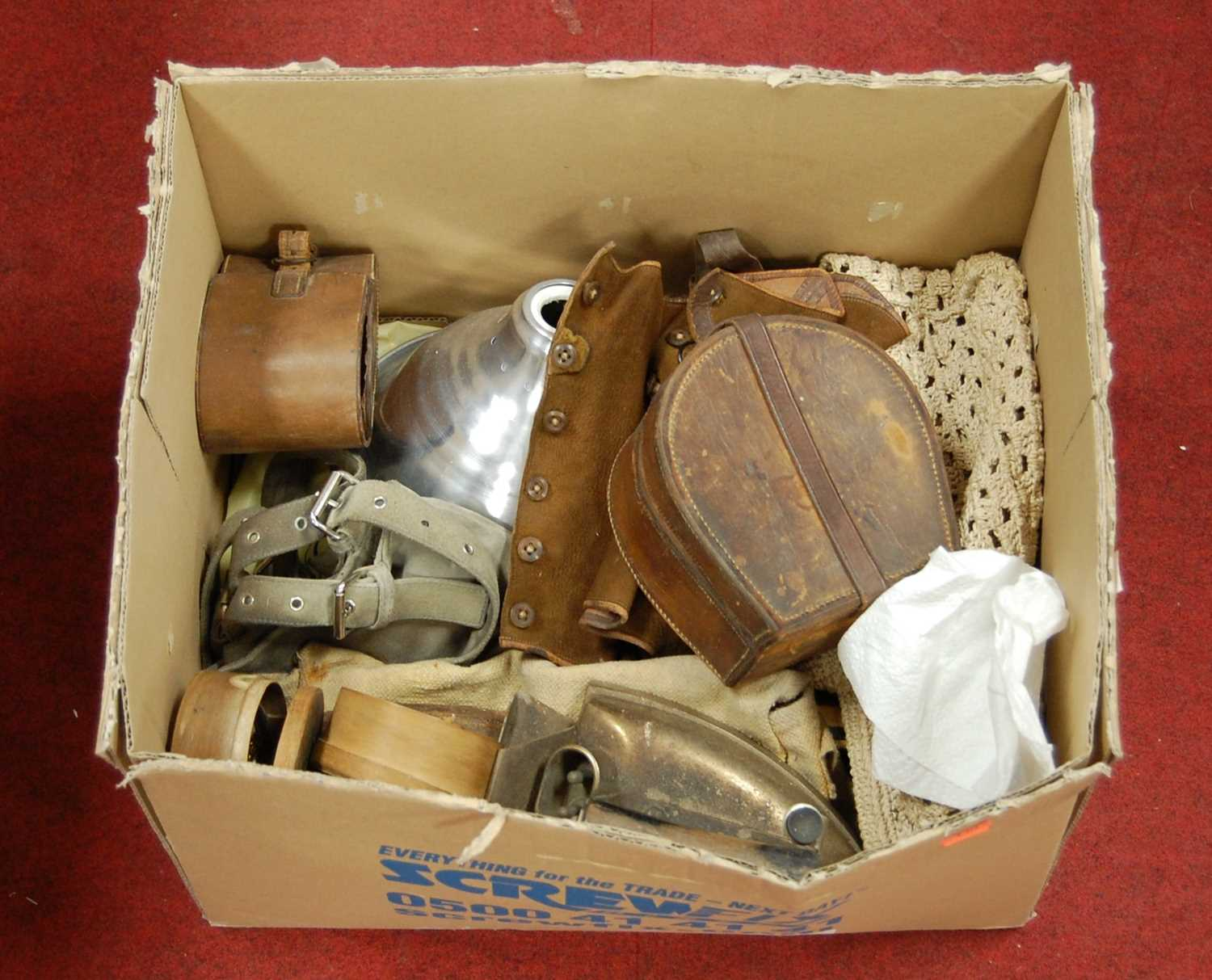 Lot 174 - A box of miscellaneous items, to include suede gaiters, flat irons, leather collar box etc
