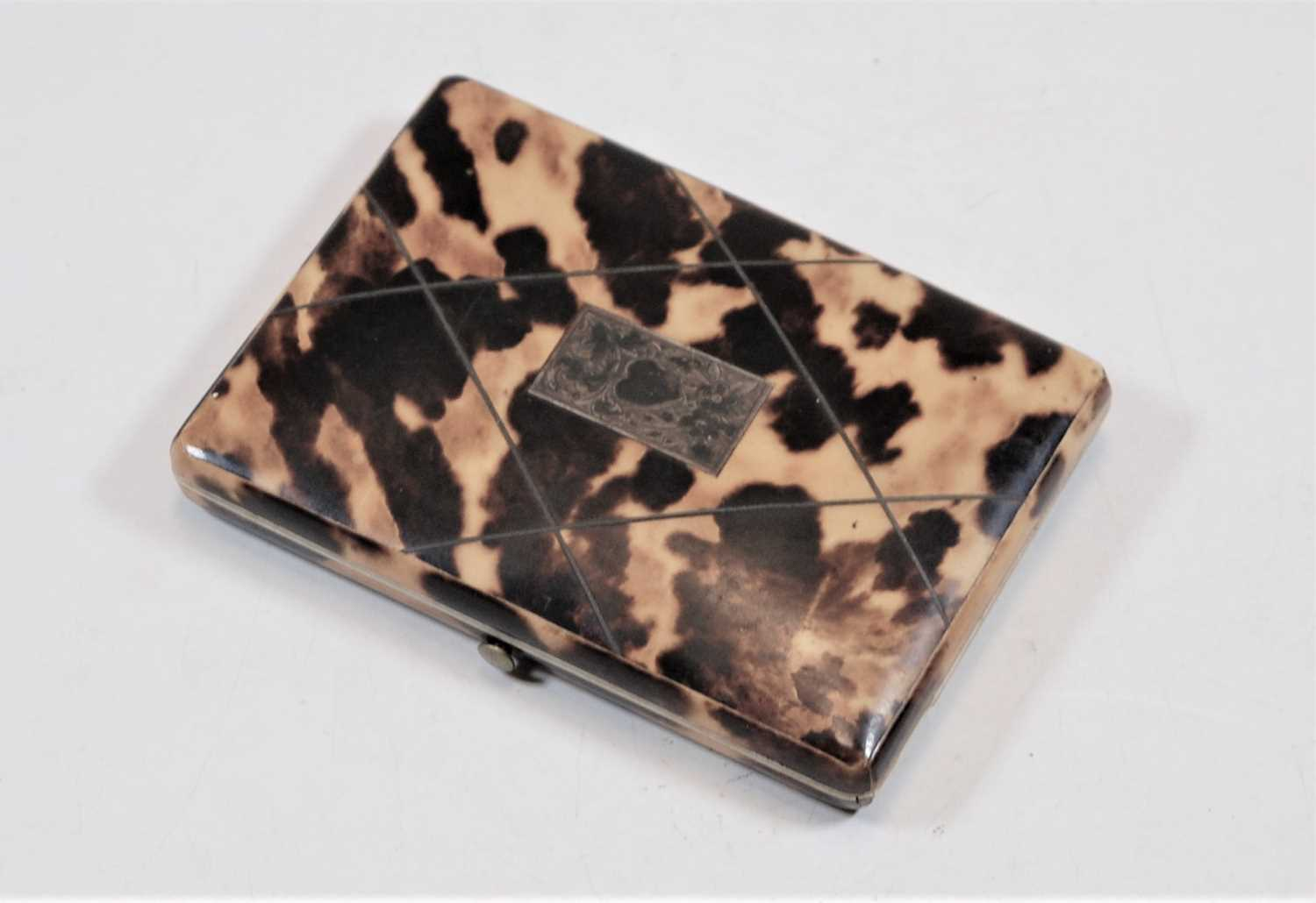 Lot 282 - A Victorian blond tortoiseshell and white metal inlaid purse, of rectangular form, having silk-lined