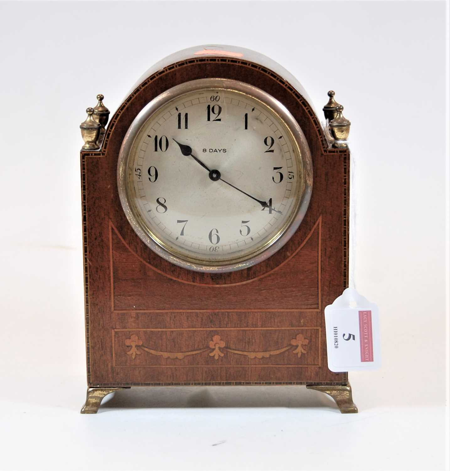 Lot 5 - A 1920s mahogany cased and chequer strung mantel clock, having a convex silvered dial with Arabic