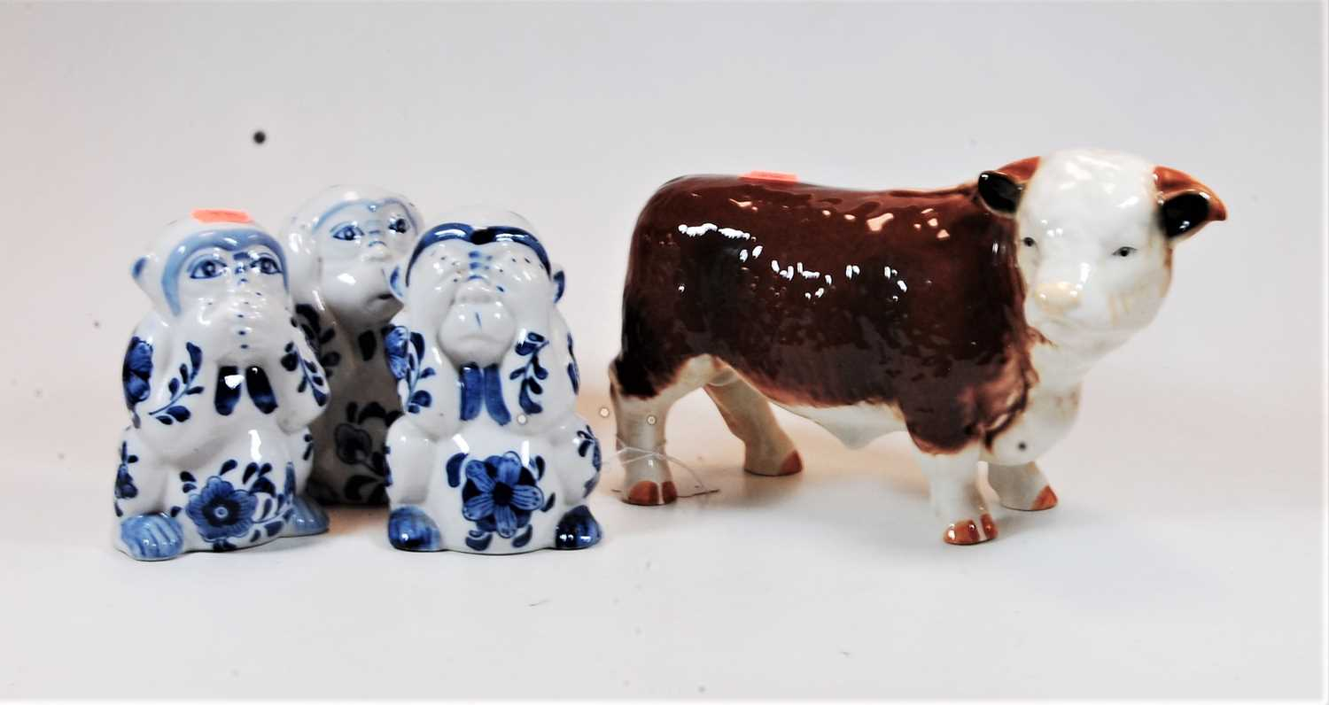 Lot 15 - A large ceramic model of a bull, width 26cm, together with three ceramic monkey figures 'See no
