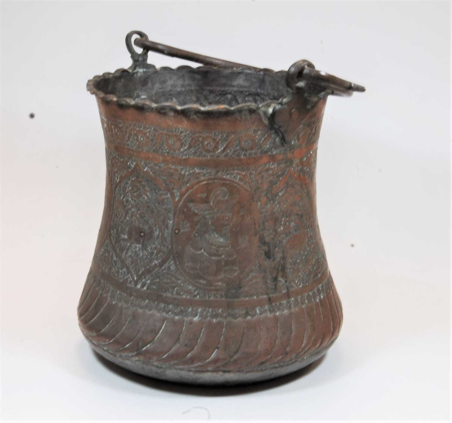Lot 6 - A late 19th century Persian copper bucket, of waisted cylindrical form, the body relief decorated