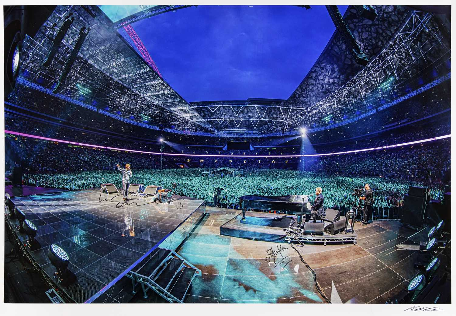 A signed Ralph Larmann Photograph of Ed Sheeran and Sir Elton John Performing Together at Wembley
