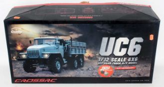 A Cross RC (radio controlled) 1/12 scale kit for a 6x6 UC6 crawling truck, appears as issued and