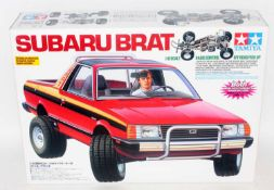 A Tamiya Model No. 58384 1/10 scale radio controlled model of a Subaru Brat Pickup truck, unmade