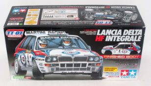 A Tamiya model No. 58342 1/10 scale radio controlled kit for a Lancia Delta HF Integral race car,