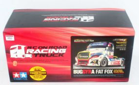 A Tamiya model No. 58661 1/14 scale radio controlled model of a Buggyra Fat Fox racing truck,