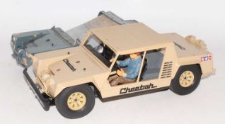 Two part made Tamiya Cheetah 1/12 scale plastic kits, one example complete, the other body shell (