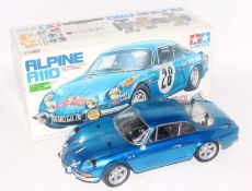 A Tamiya model No. 58168 1/10 scale kit built model of a radio controlled Alpine A110 race car,