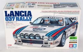 A Tamiya model No. 58278 1/10 scale boxed model of a Lancia 037 Rally car, suitable for radio