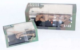 A Master Fighter by Gasoline 1/48 scale resin military vehicle and implement group to include