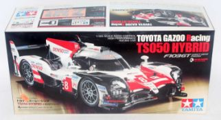 A Tamiya model No. 58665 1/10 scale radio controlled assembly kit for a Toyota Gazoo Racing TS050