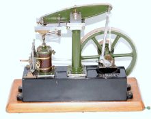 A Stuart Turner stationery beam engine comprising of green and black body with wooden clad