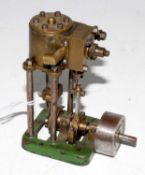 A home made cast iron steel and gunmetal model of a single cylinder vertical steam engine raised