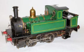 "A 7¼"" gauge live steam locomotive finished green with polished boiler bands and half cab giving"