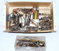 One box containing a quantity of various miniature steam engineering tools to include milling