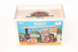 A Mamod TE1A traction engine of usual specification, sold with steering rod, scuttle, and burner,