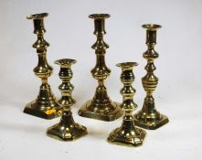 Two pairs of Victorian brass candlesticks, together with one single brass candlestick (5)