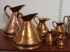 A set of seven 19th century graduated copper measures, the largest h.28cmCondition report: The