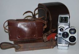 A Bell & Howell Autoset turret 8mm cine camera in fitted leather case with instruction manual,