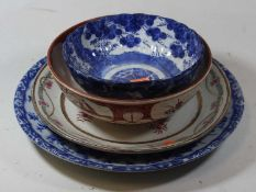 A Chinese blue and white dish, 31cm dia., together with three others (4)