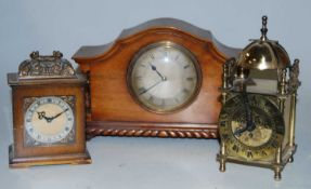 A 1920s walnut cased mantel clock having an engine turned silvered dial with Roman numerals signed