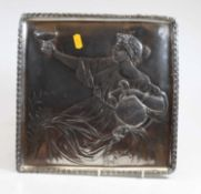 A WMF pewter square dish, relief decorated with a classical figure reclining, with Vetruvian wave