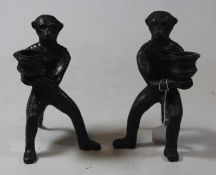 A pair of modern bronze figural candlesticks, each in the form of a monkey holding a sconce, h.16cm