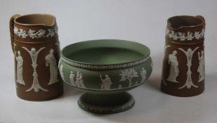 Two Wedgwood brown jasperware jugs, together with a green jasperware pedestal bowl, 22cm dia. (3)