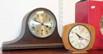 A 1930s oak cased mantel clock, having a silvered dial with Arabic numerals, and chiming movement;