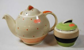 A Susie Cooper Crown Burslem Works teapot cover, together with a similar preserve pot and cover (2)
