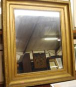 A circa 1900 gilt composition picture frame with later inset mirrorplate, 90 x 78cm