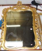 A reproduction gilt composition framed and bevelled wall mirror, 116 x 74cm
