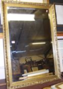 A reproduction gilt framed and bevelled wall mirror, 98 x 67cm