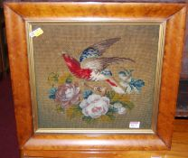 A Victorian woolwork panel, depicting bird and flowers, all housed in a birds-eye maple frame, gross