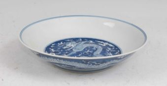 A Chinese export porcelain bowl, the centre blue & white decorated with a five clawed dragon chasing