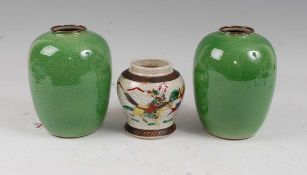 A pair of Chinese green crackle glazed vases each of ovoid form, height 17cm, together with one