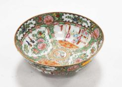 A Chinese Canton Famille Rose bowl typically decorated with various figures within a landscape