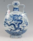 A Chinese export blue & white moon flask of slab sided circular form underglaze blue and white