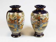 A pair of 20th century Japanese Satsuma vases, of ovoid form, decorated with figures before a