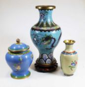 A Chinese cloisonne enamel vase of baluster form, decorated with a five clawed dragon above the