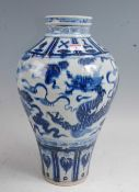 A large Chinese export stoneware Meiping vase of typical form, under-glaze blue decorated with a